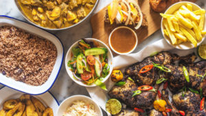 An array of Caribbean Food set at table